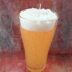เทียนเบียร์พร้อมฟองในแก้วทรงสูง ขนาด เส้นผ่านศูนย์กลางประมาณ 6 cm.สูง 14 cm.