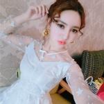 ชุดเดรสแฟชั่นเกาหลีคอกลมแขนยาวสีขาวผ้าซีทรูลายดาวทั้งชุด